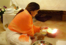 Mirabai Lighting a sacred fire during puja